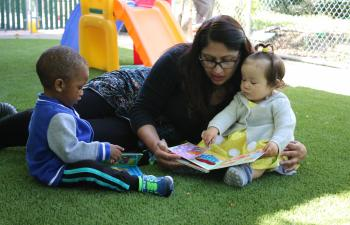 teacher reading to toddlers