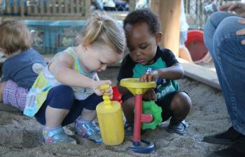 Two children in the sandbox.